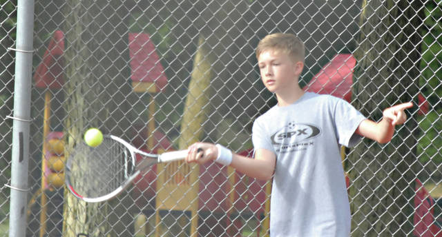 Rob Kiser|Miami Valley Today Aiden Yeager hits a forehand against Nick Von Krosigk Friday at Troy City Park.
