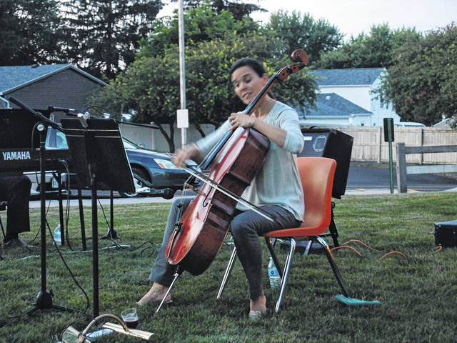 Provided photo The Milton-Union Public Library staff and participants enjoyed an evening under the stars with live music on Thursday, July 18. Tara Mar Iddings, who plays cello for the Miami Valley Symphony Orchestra, performed, along with David Zelmon, on piano. Adults and children sat on the lawn and enjoyed sparkling fruit juice, wonderful music, and a relaxing atmosphere.