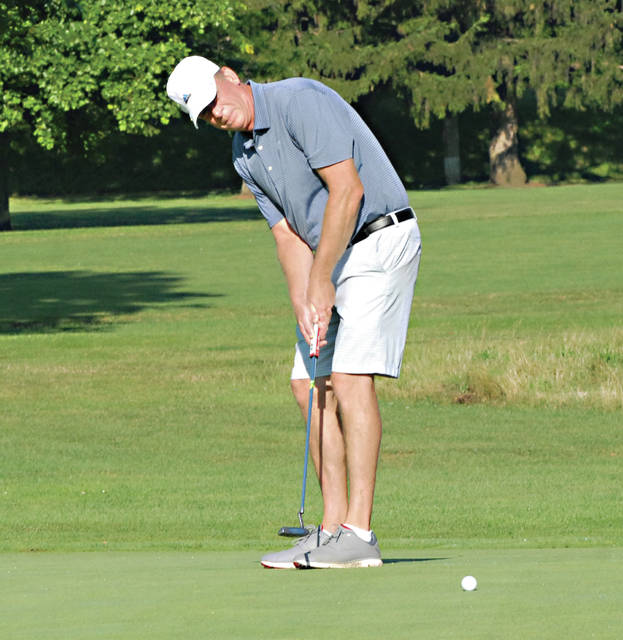 Rob Kiser|Miami Valley Today Jason Thompson watches his putt on the third green.
