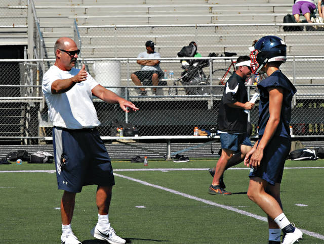Rob Kiser|Miami Valley Today Piqua football coach Bill Nees gives instruction Saturday.