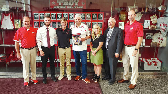 Provided photo Troy athletic director Dave Palmer, Unity Bank Troy manager Jake Boggs, recent Troy High School graduate Luke Severt, National Baseball Hall of Fame writer Hal McCoy, Katherine Severt, Todd Severt and Troy High School principal Dave Dilbone pose together Wednesday, July 17 at Troy High School as Luke Severt is presented with the <em>Press Pros Magazine</em> 2019 Hal McCoy scholarship, which is given annually to a local high school senior who plans to major in journalism.