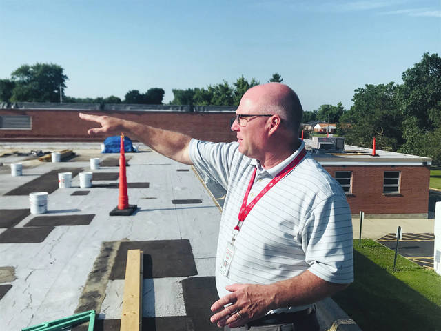 Provided photo Troy City Schools Director of Transportation, Facilities and Maintenance Tytus Jacobs gives an overview of the roof replacement project taking place this summer at Cookson Elementary School. Roughly 40 percent of the roof at Cookson will be replaced this summer.