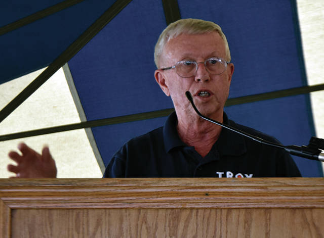 Troy Mayor Mike Beamish offers an opening prayer during opening ceremonies for the 2019 Miami County Fair, on Friday. This was Beamish's 16th, and final, opening ceremony as mayor of the City of Troy.