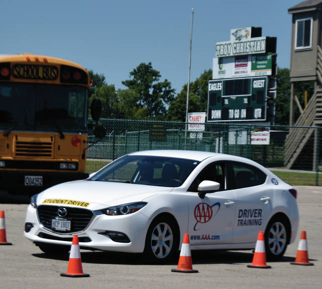 The Miami County AAA hosted their annual meeting of the Miami County Safe Communities Coalition at Troy Christian High School on Friday. The event was attended by representatives of a number of law enforcement agencies from the county. New this year was an opportunity for driver's education students from Troy Christian to drive a closed course while wearing impaired driving goggles. The experience allows young drivers to learn the dangers of operating a motor vehicle while impaired. ©2019 Miami Valley Today. All rights reserved