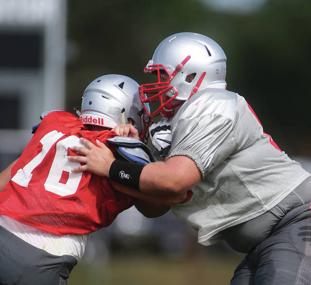 Lee Woolery|Miami Valley Today Troy's Ethan Freed (66) blocks Sean Keenan (76) during the Trojans' Scarlet and Gray Intrasquad Scrimmage Saturday at Ferguson Field.