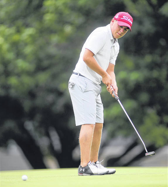 Lee Woolery|Miami Valley Today Troy's Ryan Dowling sinks a putt at the Troy Invitational Monday at Troy Country Club.