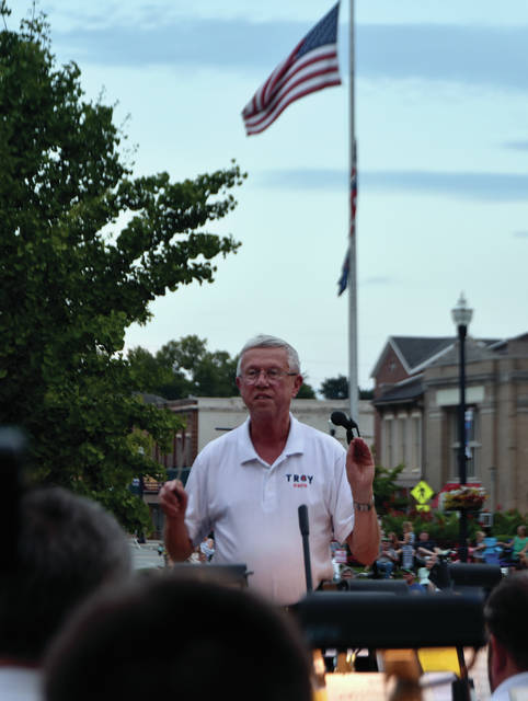 Troy Mayor Mike Beamish conducts Dayton Philharmonic Orchestra in <em>His Honor March</em> during the annual Mayor's Concert on Prouty Plaza on Sunday. The concert was Beamish's 16th and final concert as Mayor of Troy.