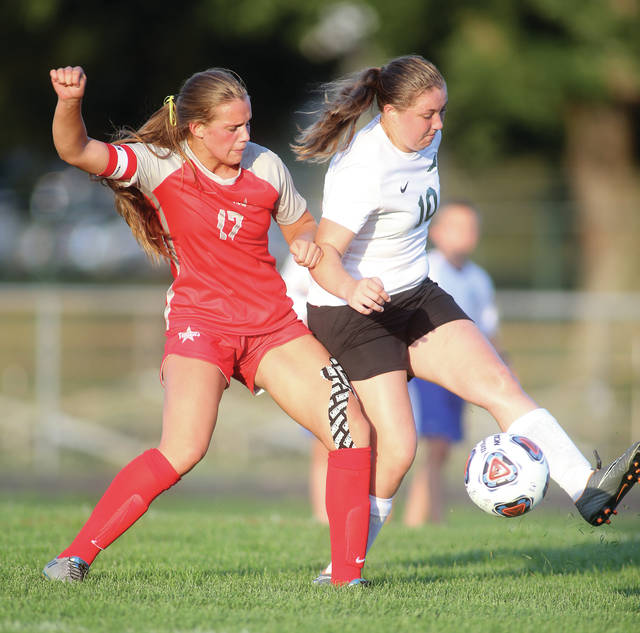 Lee Woolery|Miami Valley Today Troy's Julianna Williams battles Greenville's Chloe Sowry for the ball Wednesday at Troy Memorial Stadium.