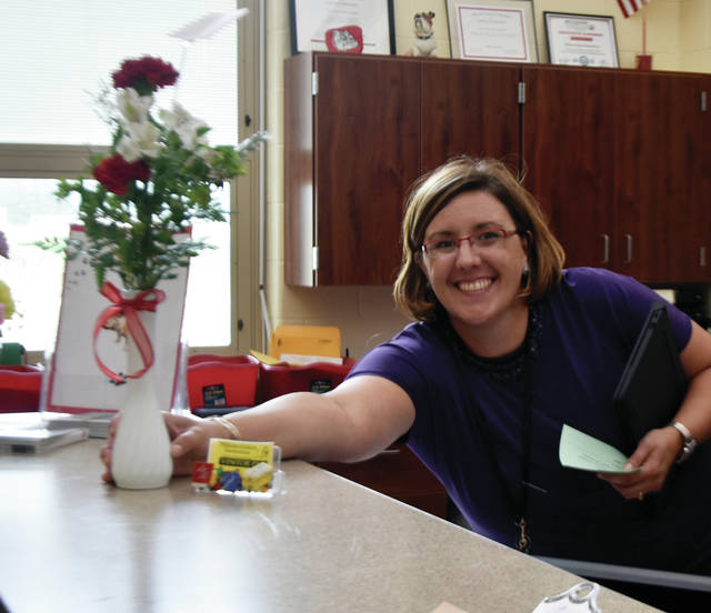 Milton-Union Schools 4th grade teacher Mrs. Michelle Lane receives a gift of flowers to brighten her day on the first day of school for the 2019-20 school year.
