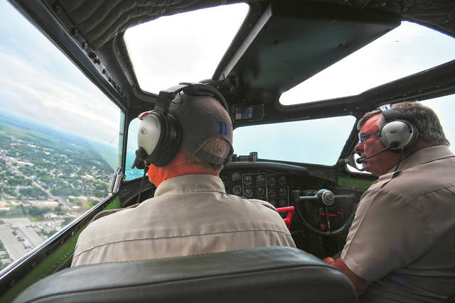 EAA Pilot Neil Morrison makes a turn over Richmond, IN in B-17 Aluminum Overcast on Thursday during a media flight in the rare warbird.