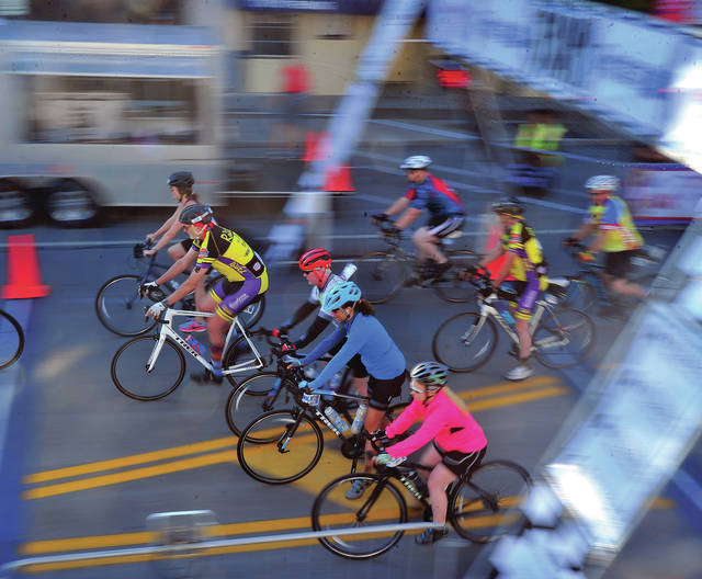 The 2019 Troy Tour de Donut gets underway on Saturday morning. Some 3,000 riders took part in the event. ©2019 Miami Valley Today. All rights reserved