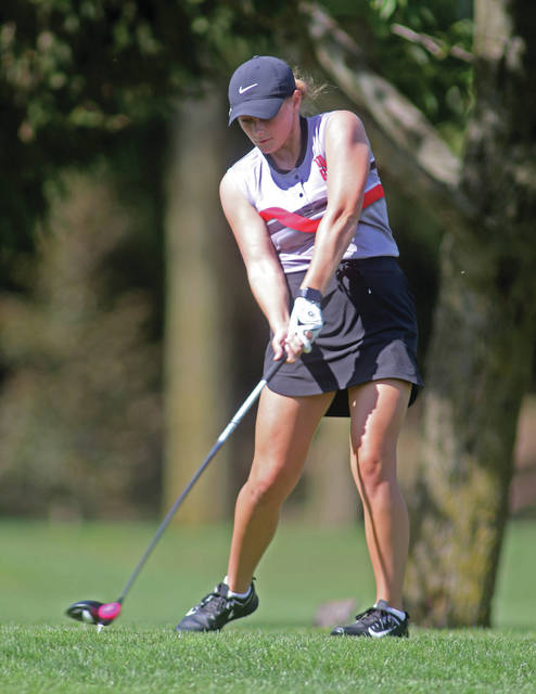 Lee Woolery|Miami Valley Today Troy's Paige Stuchell hits a drive during a match against Beavercreek Wednesday at Miami Shores Golf Course.