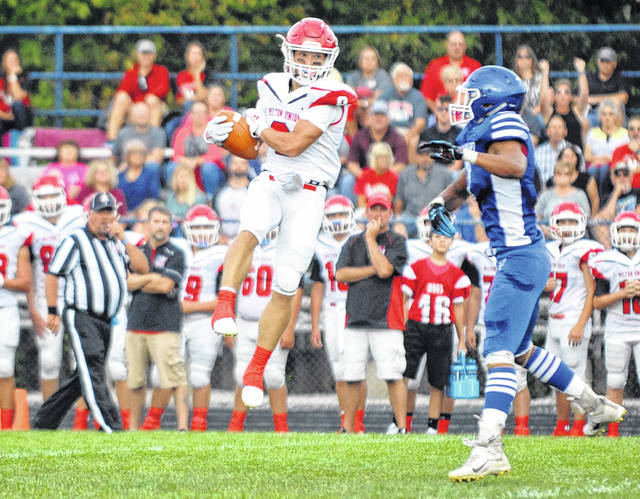 Josh Brown|Miami Valley Today Milton-Union's A.J. Lovin catches a pass Friday at Miami East. Lovin scored six touchdowns in the Bulldogs' 46-15 victory.