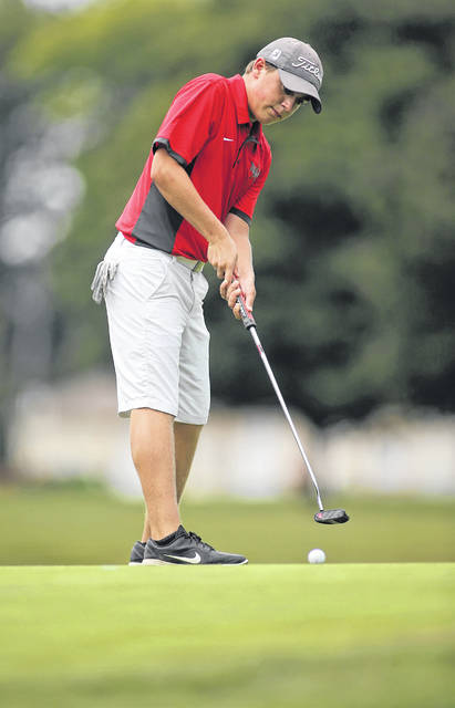 Lee Woolery|Miami Valley Today file Troy's Ryan Dowling putts during a match last season.