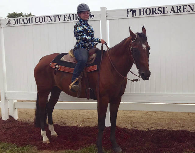 Melody Vallieu | Miami Valley Today MacKenzie Andrews, 12, of Troy, and a member of Society's Blazing Broncos, won Grand Champion Easy-Gaited Western Horsemanship Overall and Champion Easy-Gaited Western Horsemanship, 9-12. She is the daughter of Greg and Tracy Andrews.