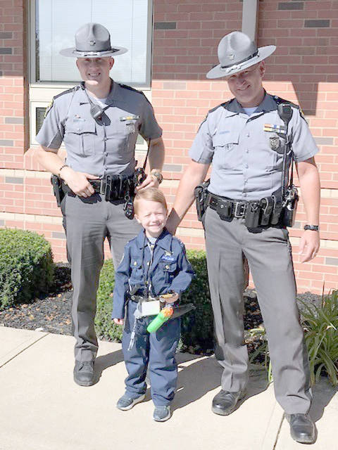 Brooks Deaton of Tipp City recently got a birthday surprise when two Ohio State Highway Patrol officers stopped by to help him celebrate this 5th birthday. His mother, Allana Deaton, said Brooks dreams of being a police officer and was excited to have the visit.