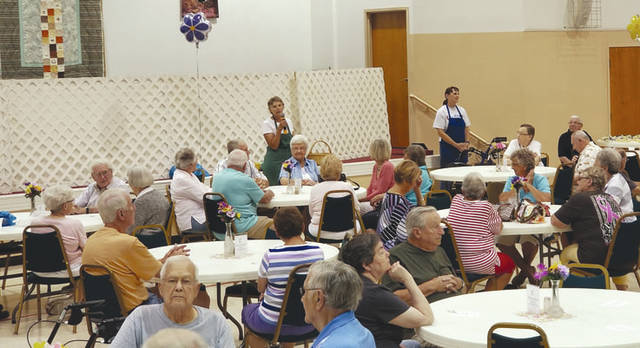 Provided photo Area residents attend Grandma's Kitchen, a community-oriented mission of Hoffman United Methodist Church, celebration of their 18th year of serving meals.