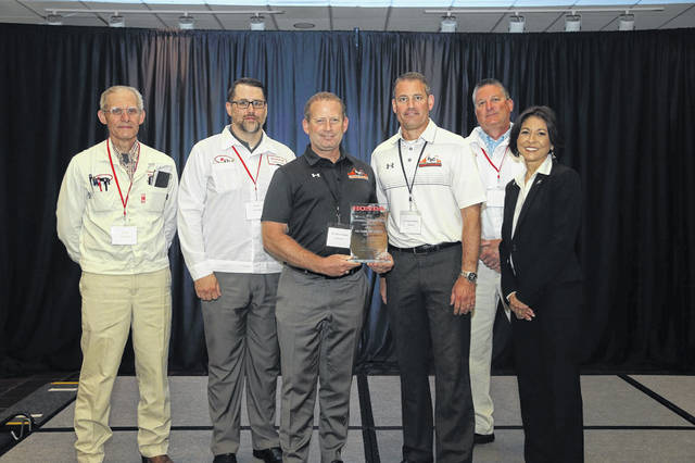 Pictured left to right are Tony Walker from Honda, Mathew Daniel from Honda, Randy Sever from PSC Crane & Rigging, Jim Sever from PSC Crane & Rigging, Chris Walker from Honda and Monica Oliverio from Honda.