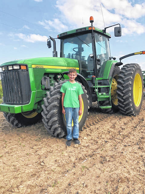 "Miami Valley Today Lee Morrow, 10, of Covington, will have his 4-H project ""Starting Up: Getting to Know Your Tractor"" on display along with hundreds of other 4-H projects at the Duke Lundgard Building during the Miami County Fair."