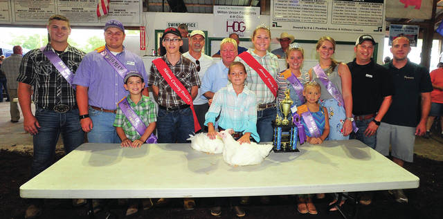 Grand Champion Market Chicken, exhibited by Myah Romer, of Troy, was purchased for $3,000. She is the daughter of Cortney and Adam Romer. The buyers were Steve Zell and Francis Furniture of Troy, Kevin Romer, Ryan Havenar and Ron Erwin of Erwin Dodge Jeep in Troy. It was a new sale record.