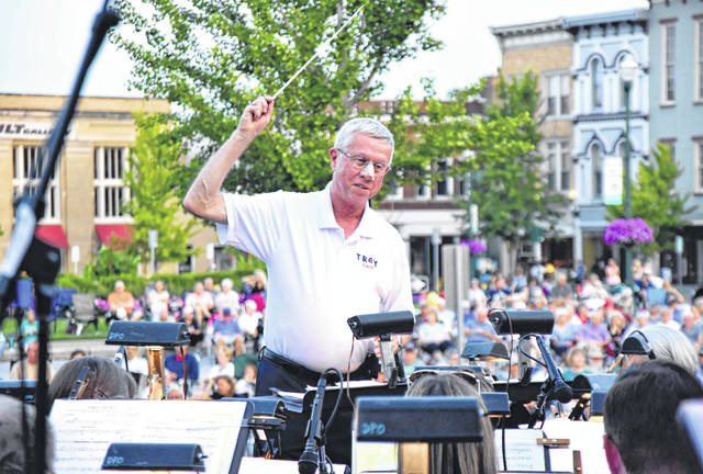 """Miami Valley Today file art Mayor Mike Beamish serves as conductor to a rendition of """"His Honor March"""" during the 2018 Troy Mayor's Concert with the Dayton Philharmonic Orchestra."""