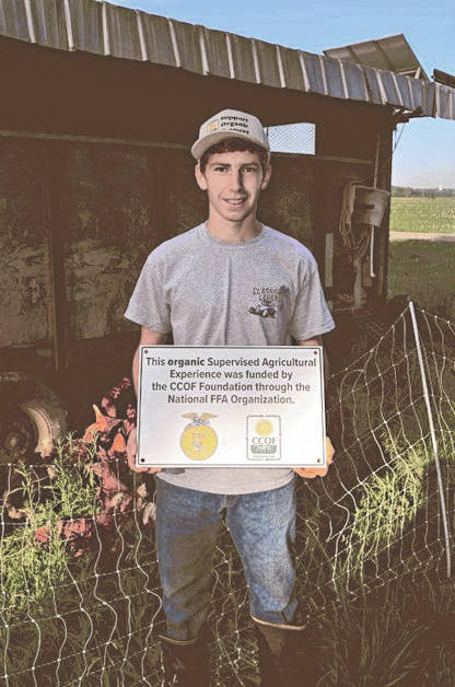 Michael Bair, 17, a junior at Miami East High School and FFA member, was invited to speak about his organic chicken operation at the California Certified Organic Farmers eastern conference in Baltimore, Md. on Sept. 12. Bair received two grants from their foundation to assist in his organic operation, which is part of his FFA Supervised Agriculture Experience.
