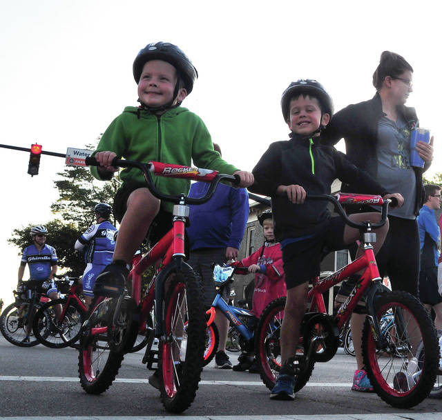 Twin brothers William and Thomas Behm, 5, of Troy wait for the starting signal for Saturday morning's children's Tour de Donut ride.