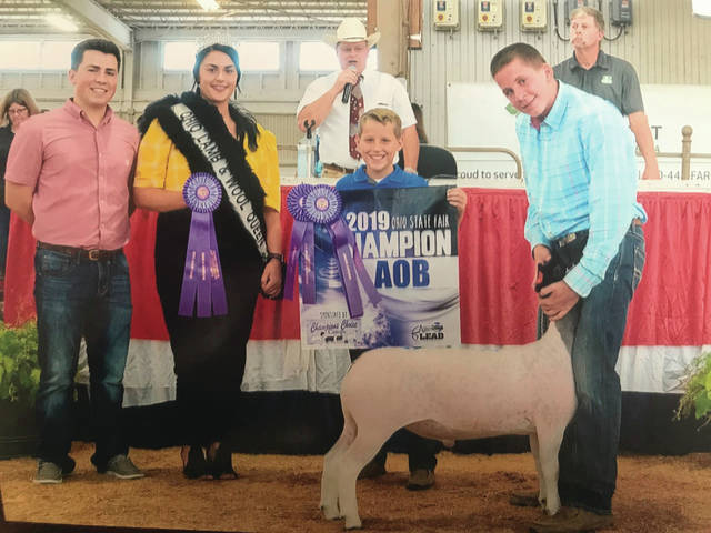 Provided photo Jacob Roeth of Troy exhibited the Champion All Other Breeds Market Lamb at the 2019 Ohio State Fair. Stone competed against 273 exhibitors with 699 market lambs to win this honor. Brian Reilly of Shullasburg, Wisc., judged the July 24 competition. GE Baker Construction, Mark Banbury Memorial Show, OSIA LEAD Council, Banner Booster Program sponsors, Marketing Advantage Sale sponsores Roeth's lamb for $1,565 at the fair's Market Lamb Sale. He is the son of Justin Roeth and a member of the Frisky Critters 4-H Club.