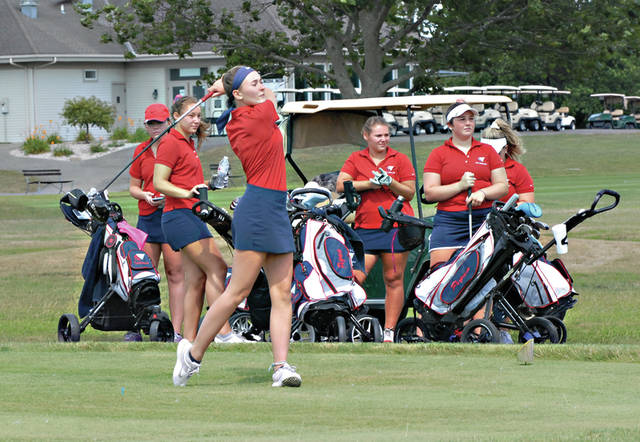 Rob Kiser|Miami Valley Today Piqua's Adde Honeycutt hits the opening tee shot in the match with Sidney Tuesday as her teammates look on.