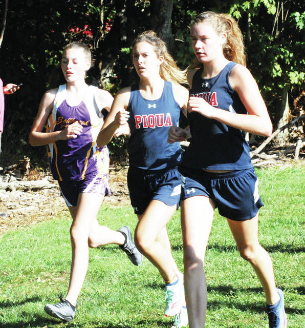 Rob Kiser|Miami Valley Today Piqua' Cassie Schrubb and Ana Adams run at the Bob Schul Invitational Saturday.