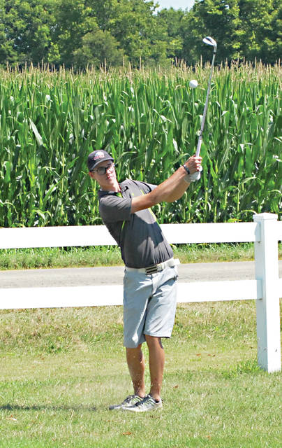 Rob Kiser|Miami Valley Today Andrew Slusher pitches on to the 18th green Saturday at Echo Hills.