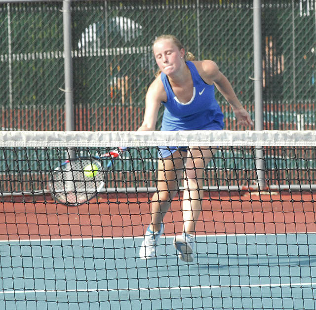 Rob Kiser|Miami Valley Today Lehman Catholic's Angela Brunner chases down a drop shot in a singles match with Arabell Partee Wednesday.