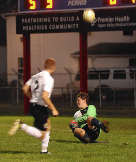 Rob Kiser|Miami Valley Today Piqua goalies Deacon Buechter deflects a Sidney shot Tuesday night to preserve his shutout.