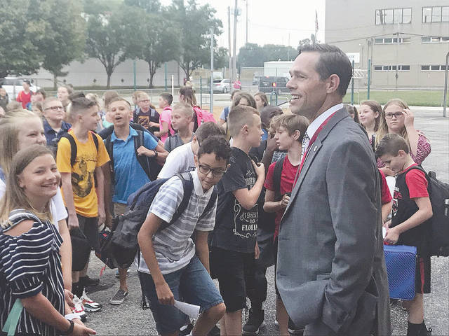 Provided photo Van Cleve Sixth Grade Building Principal Matt Siefring greets students Wednesday prior to the start of the first day of school for the 2019-20 school year.