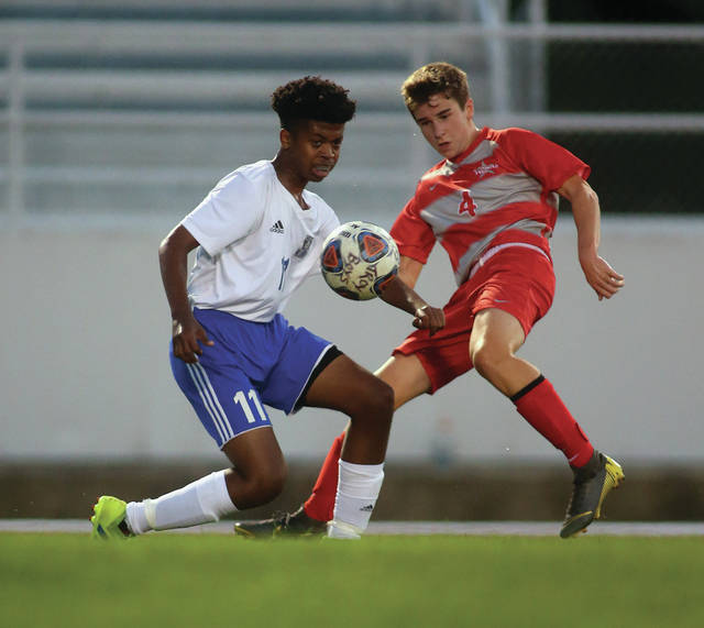Lee Woolery Miami Valley Today Troy's Sam Kazmaier battles Xenia's A.J. Ruffin for the ball Tuesday at Troy Memorial Stadium.