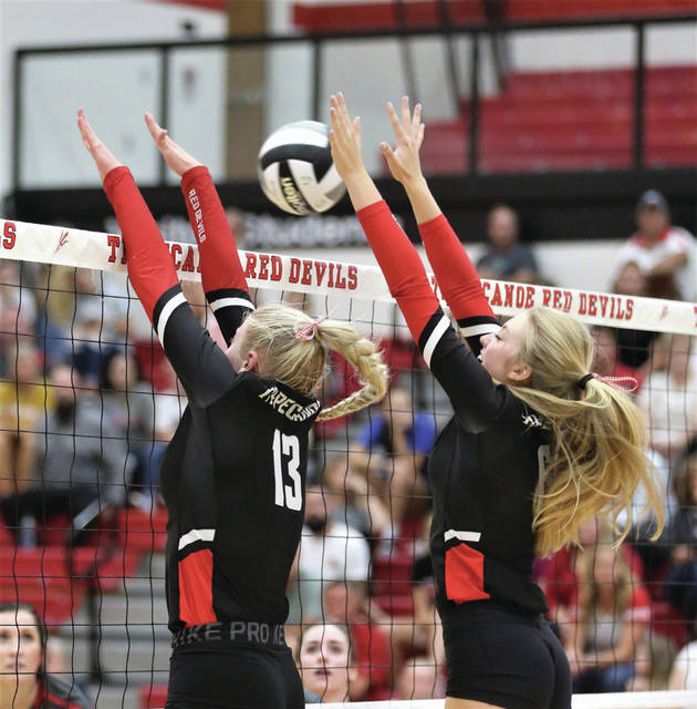 Lee Woolery|Miami Valley Today Tippecanoe's Corinn Siefring (13) and Molly Achtenberg (6) go up for a block Wednesday against Troy.