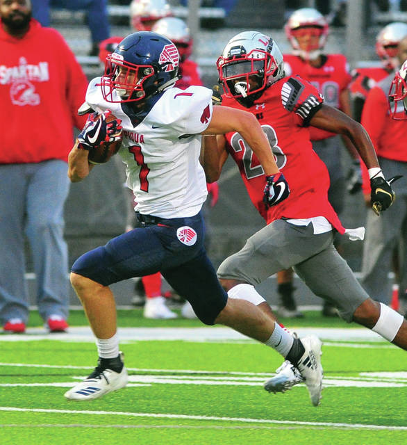 Piqua's Tanner Kemp races for the end zone and a Piqua touchdown Friday night against Lima Senior at Spartan Stadium.