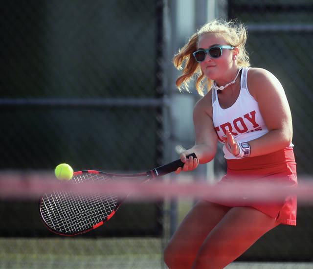 Lee Woolery|Miami Valley Today Troy's Cady Rhea hits a volley at first doubles Tuesday against Sidney at Troy High School.