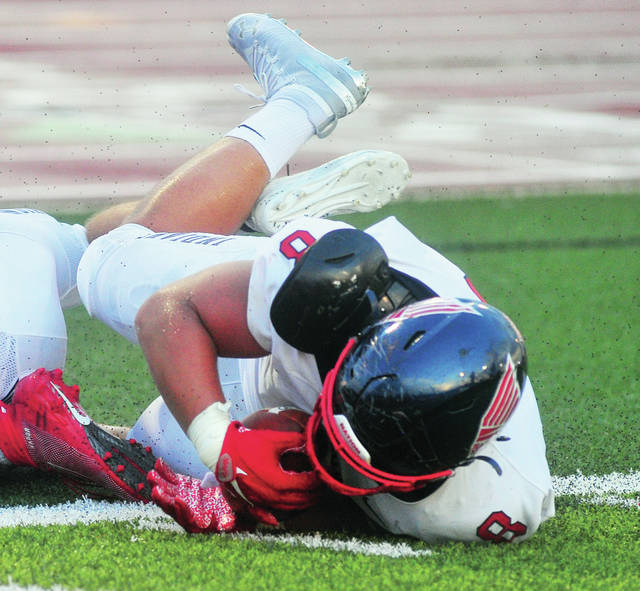 Piqua's Jarrell Lewis recovers a fumble on the Stebbins one-yard line Thursday night in Piqua]s 27-10 victory.
