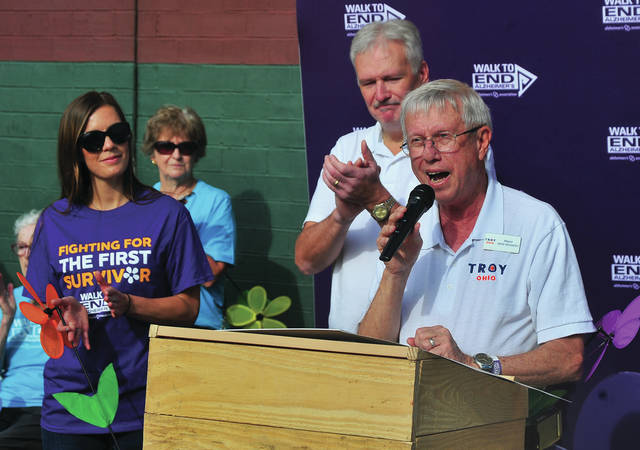 Troy Mayor Mike Beamish, right, along with Tipp City Mayor Joe Gibson, center, and state Representative Jena Powell, left, present a proclamation recognizing the fight to end Alzheimer's during Saturday's Walk to end Alzheimer's at Prouty Plaza in Troy.
