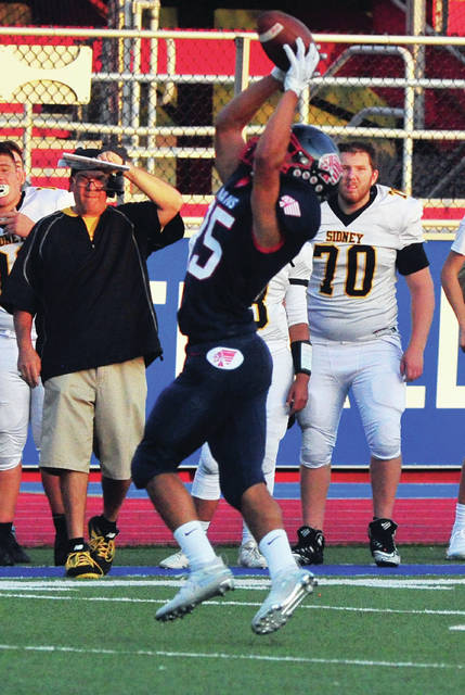 Mike Ullery|Miami Valley Today Piqua's Ca'ron Coleman makes a leaping catch for the Indians in the first quarter Friday night against Sidney.