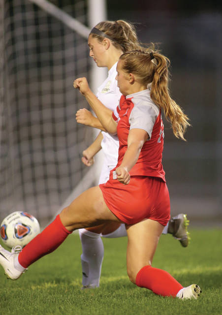 Lee Woolery|Miami Valley Today Troy's Julianna Williams hits a shot around a Sidney defender and scores Wednesday night at Troy Memorial Stadium.