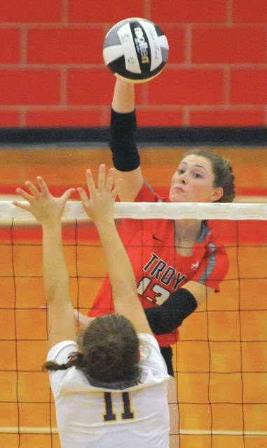 Josh Brown|Miami Valley Today Troy's Lauren Schmitz goes up for a kill Thursday against Butler.