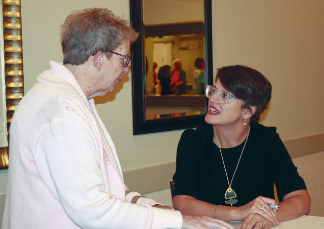 Provided photo Kelly Corrigan, right, talks with a cancer awareness symposium attendee.