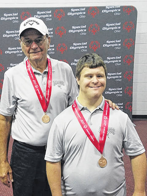 Provided photo Volunteer Harry Bashore and Matt Hickman competed in the Ohio Special Olympics Golf Tournament on September 17 at Meadow Links & Golf Academy in Cincinnati. The pair was one of seven sets to compete at State. The pair earned a bronze medal.