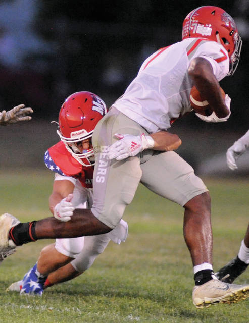 Milton-Union's A.J. Lovin tackles Northridge's Matthew Moon Friday night.