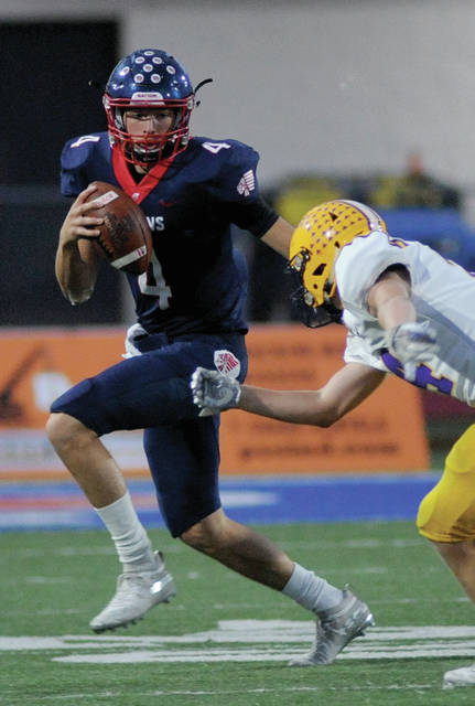 Piqua quarterback Blane Ouhl rolls out in a win over Vandalia-Butler Friday night at Alexander Stadium|Purk Field. Amanda Prior| Miami Valley Today
