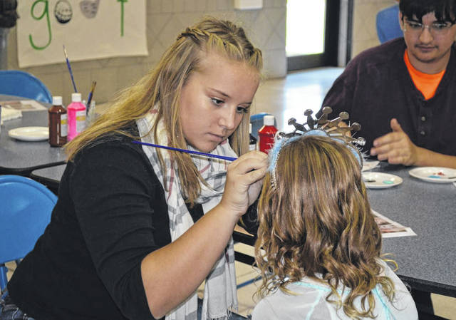 Provided photo Miami East-MVCTC FFA Member Kaitlyn Roop is face painting a young princess at the 2018 Princess For a Day. All young princesses are welcome to join the Princesses For Day event on Saturday, September 28 at Miami East High School.