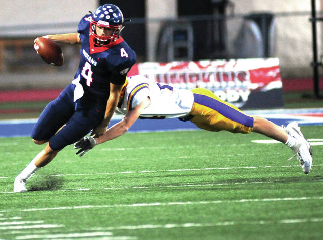 Amanda Prior| Miami Valley Today Piqua quarterback Blane Ouhl avoida a tackle Friday night against Vandalia-Butler.