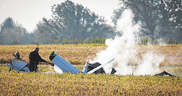 AP Photo Smoke fills the sky after a fatal plane crash at Madison County Airport on Wednesday, Sept. 18 in London, Ohio. State troopers say one person has died in the crash at a county airport, roughly 30 miles southwest of Columbus.